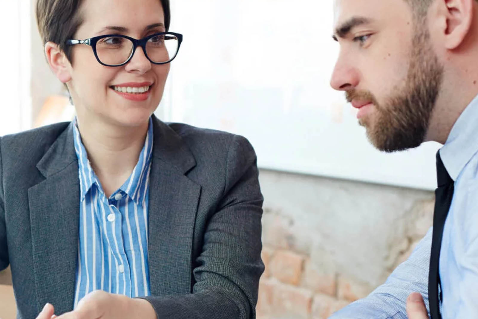 a smart male and female discussing business